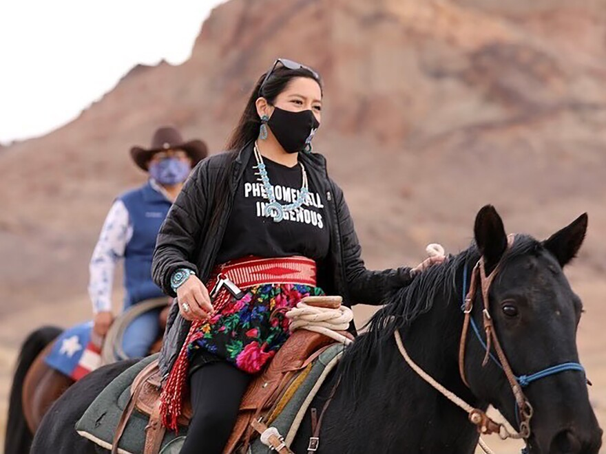 Allie Young, a Diné woman on the Navajo Nation in Arizona, is among a group of Native Americans as they ride on horseback to the polls on Election Day.