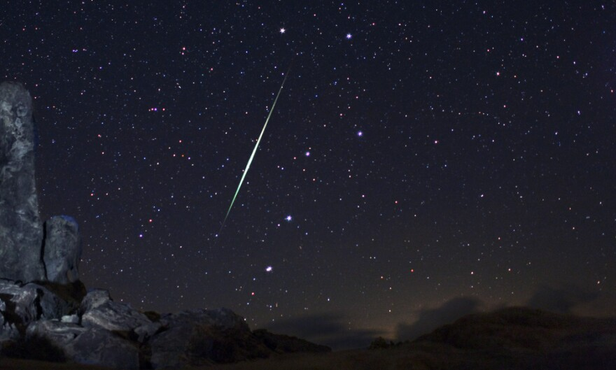 In this picture provided by Wally Pacholka of AstroPics.com, a Geminid fireball explodes over the Mojave Desert in the Jojave Desert, Calif. on Dec. 13, 2009.