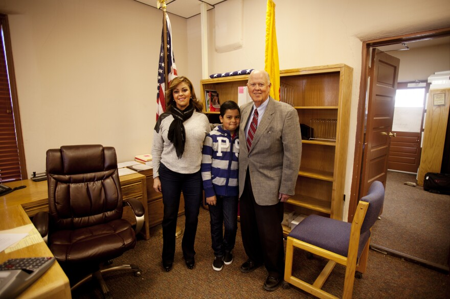 Phillip Skinner, former real estate developer and <em>maquiladora</em> owner-turned politician and school bus driver, stands with his wife, Diana, and son, Matthew, 10, moments after his mayoral inauguration.