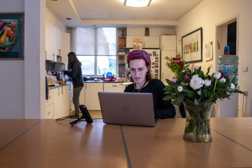 Michelle Farber, 47, a New York native who teaches a daily Talmud class for women from her living room table in Raanana, a suburb of Tel Aviv. After a morning class Farber uploads her podcast.