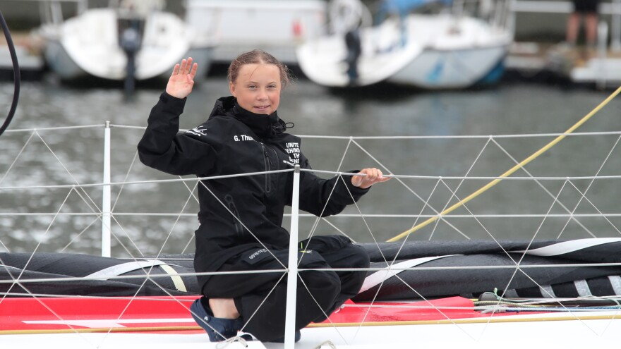Greta Thunberg, a 16-year-old Swedish climate activist, arrived in New York Wednesday aboard a boat rather than a plane to emphasize the need to reduce carbon-emission damage to the planet.