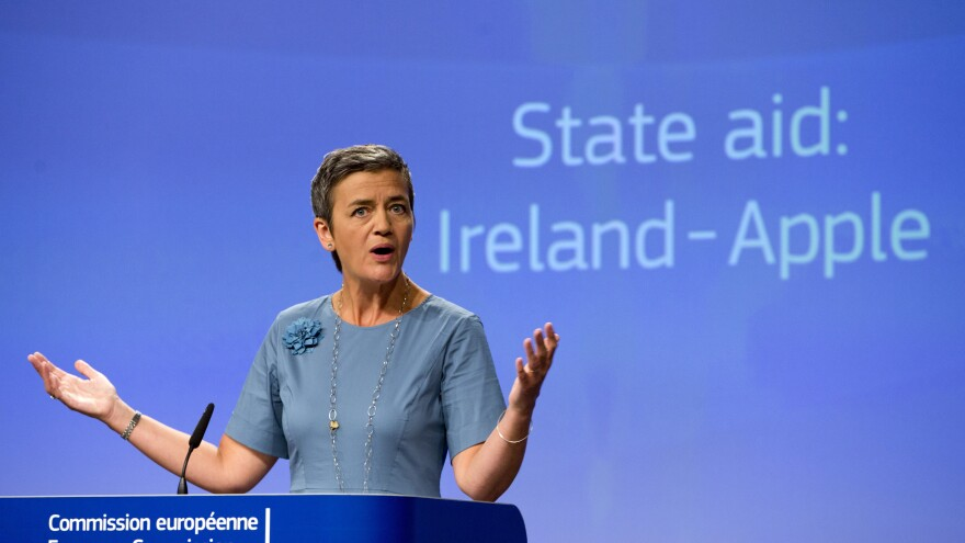 European Union Competition Commissioner Margrethe Vestager speaks during a media conference at EU headquarters in Brussels on Tuesday. The European Union says Ireland has given illegal tax benefits to Apple Inc. and must now recover the unpaid back taxes from the U.S. technology company, plus interest.