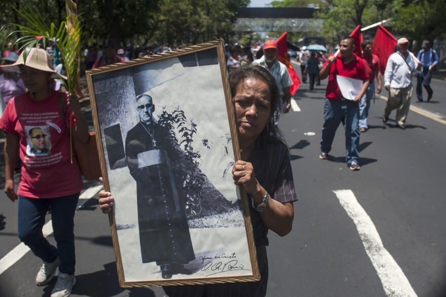 Maria del Pilar Perdomo holds up a framed portrait of the slain Archbishop of San Salvador, Oscar Arnulfo Romero, during a procession on March 24 to mark the 35th anniversary of his assassination in San Salvador, El Salvador. Romero was killed in 1980 while offering Mass. Romero will be beatified on Saturday.