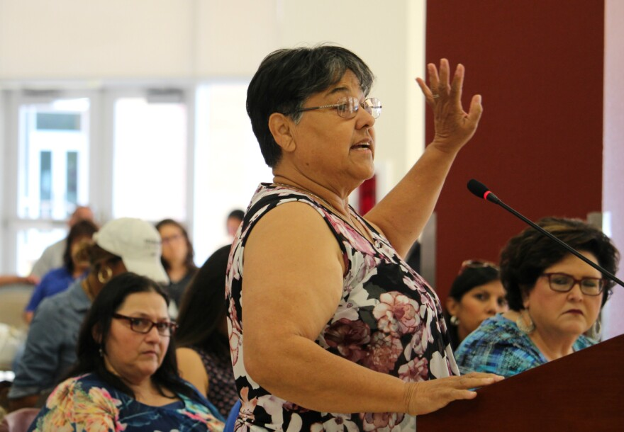 Rose Garcia speaks at a public hearing on the result of a state investigation into Harlandale ISD August 1, 2019.