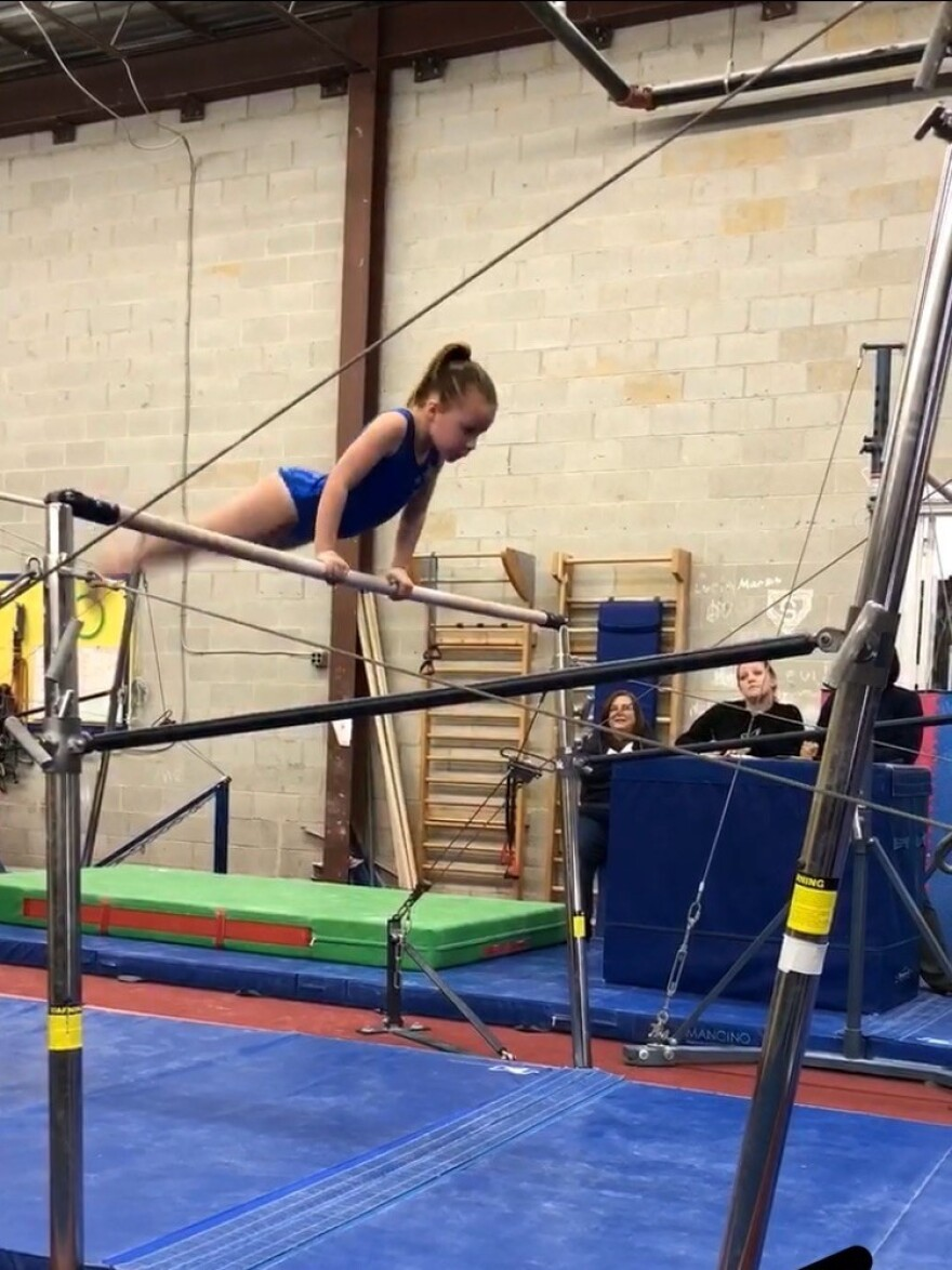 """Eight-year-old Adele at Silver Stars in Maryland. """"Gymnastics is her life,"""" her mother Lowrey Redmond says."""