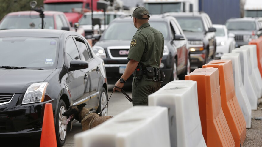 A Border Patrol agent keeps watch at a checkpoint station in Falfurrias, Texas, where a group of high school students were stopped in late June.