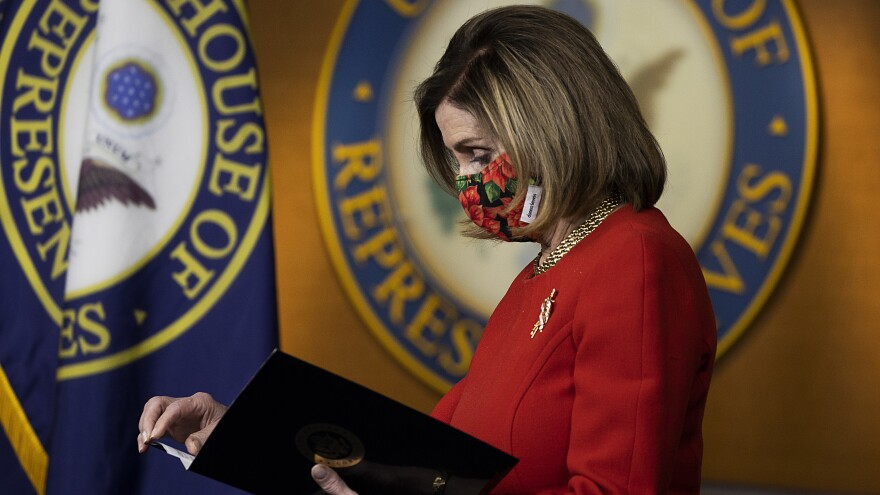 Speaker of the House Nancy Pelosi, D-Calif., holds a press conference on Sunday. Congress is scrambling after President Trump blasted a major aid and spending package that lawmakers passed Monday.