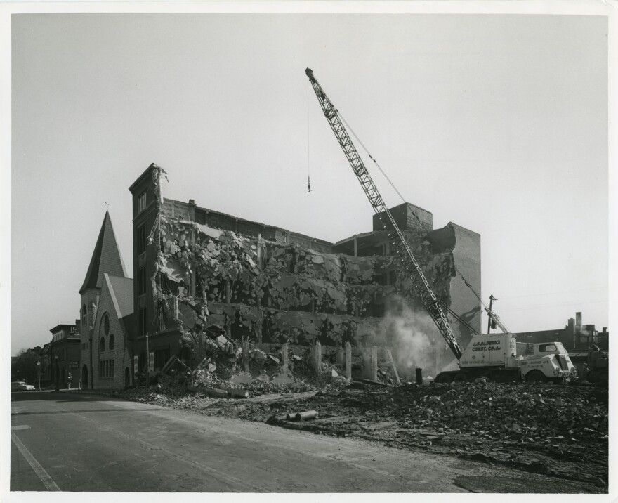 One of the largest reinforced-concrete buildings in Mill Creek Valley is demolished in January 1960.