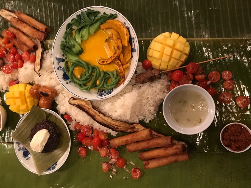 A kamayan is a communal-style Filipino feast, composed of colorful arrays of food that are usually served on banana leaves and eaten without utensils.