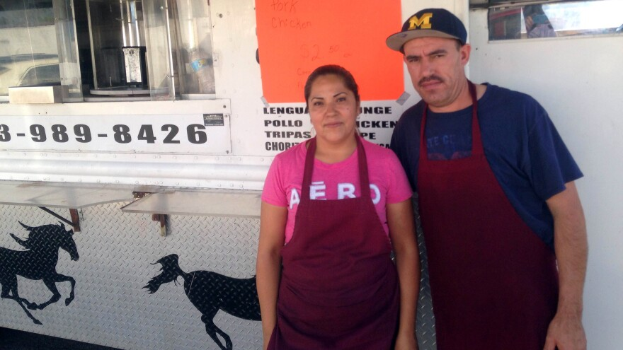 Nancy Paz and Jose Badajoz stand in front of their taco truck, which they positioned near the church Donald Trump visited Saturday morning.