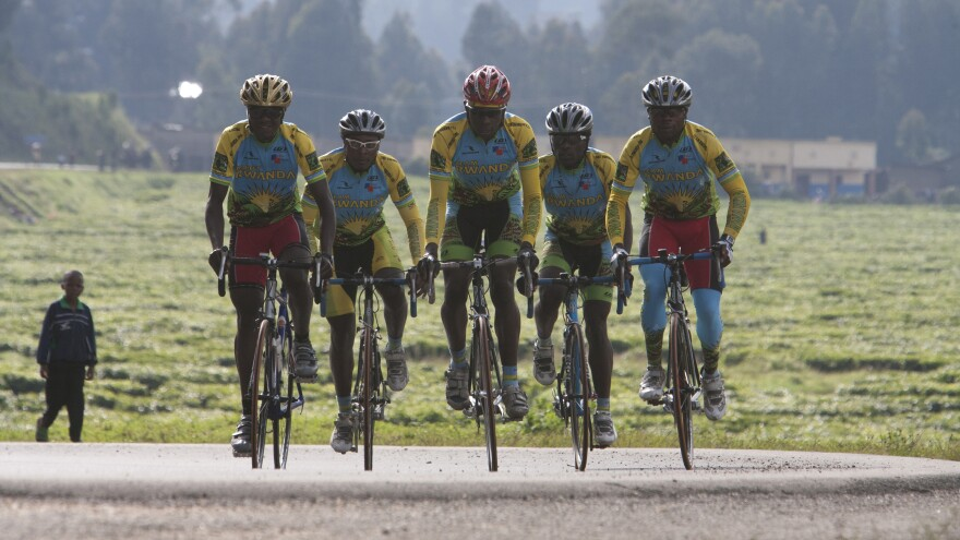 Team Rwanda rides together in a scene from the 2013 documentary <em>Rising From Ashes.</em>