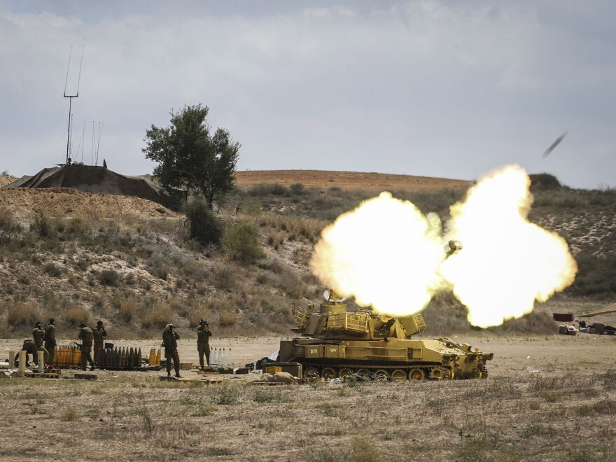 """An Israeli artillery shell is fired at the border with Gaza on Friday near Sderot, Israel. Late Thursday night Israeli forces escalated their operation with a ground offensive, sending troops into Gaza. More than 250 Palestinians have lost their lives since Israel began operation """"Protective Edge."""""""