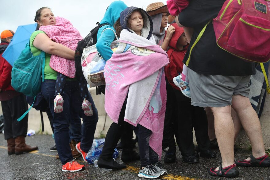 Evacuees wait to be transported to a shelter after being rescued from the flooding of Hurricane Harvey on Aug. 30, 2017 in Port Arthur, Texas. (Joe Raedle/Getty Images)