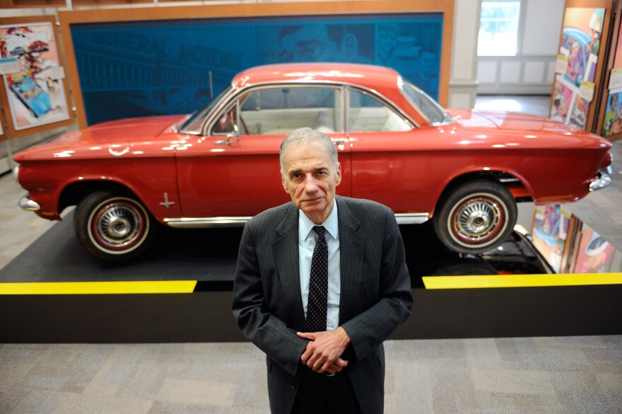 Consumer advocate Ralph Nader poses in front of a Chevrolet Corvair in the American Museum of Tort Law in Winsted, Conn. Nader featured the Corvair in his 1965 book on the auto industry's safety record, <em>Unsafe At Any Speed</em>.