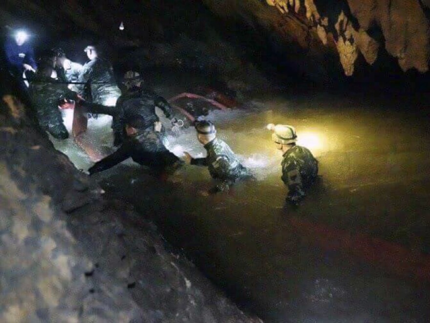 Earlier this month, Thai rescue teams walk inside cave complex where 12 boys and their soccer coach went missing in northern Thailand.