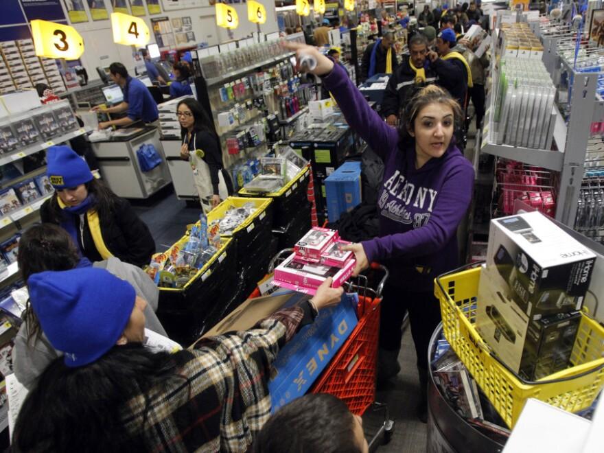 Customers crowd into a Best Buy store in Burbank, Calif., on Nov. 25.