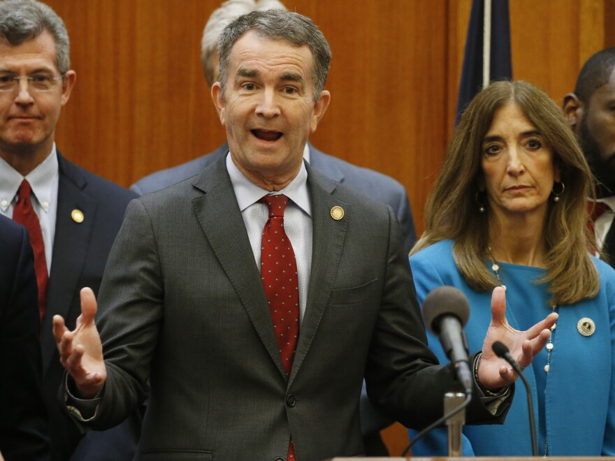Virginia Gov. Ralph Northam (front) announced that schools in the state will remained closed for at least the rest of the academic school year.