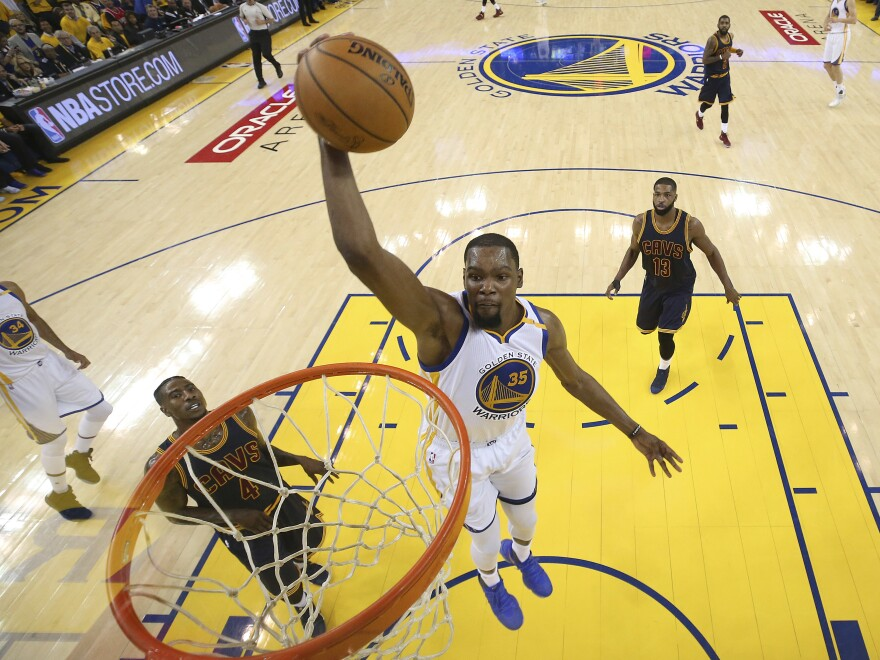 Golden State Warriors forward Kevin Durant (35) dunks against the Cleveland Cavaliers during the first half of Game 1 of basketball's NBA Finals in Oakland, Calif.