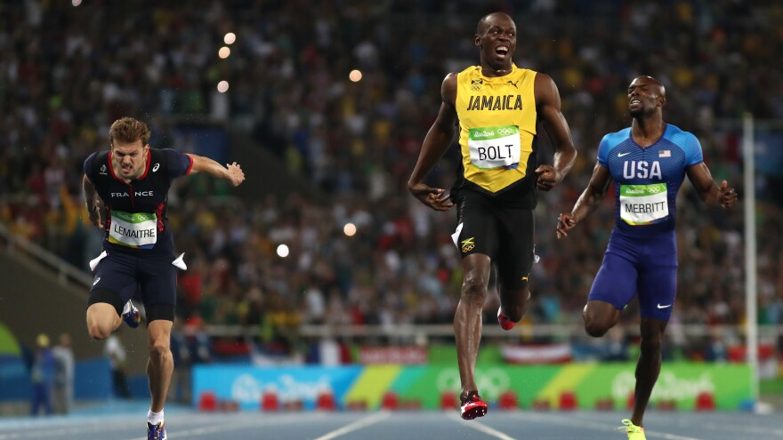 Sprinter Usain Bolt of Jamaica celebrates after crossing the finish line to win the mens 200m final at the Rio 2016 Olympic Games at the Olympic Stadium Thursday night.