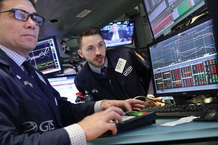 Traders work on the floor of the New York Stock Exchange, which has seen a topsy-turvy couple of days, on Tuesday in New York City.