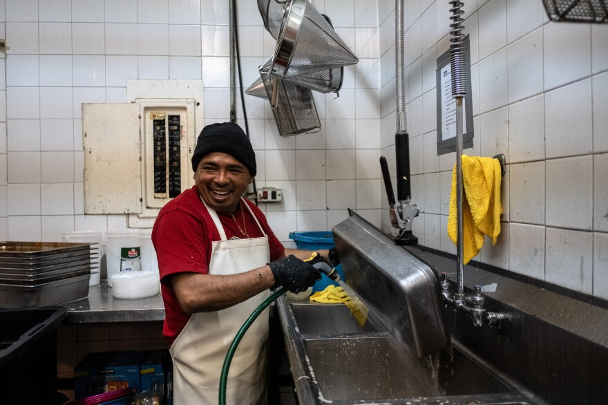 Santos Favian Gomez washes dishes for a humanitarian group, World Central Kitchen. He says he fled marauding gangs in Choluteca, Honduras.