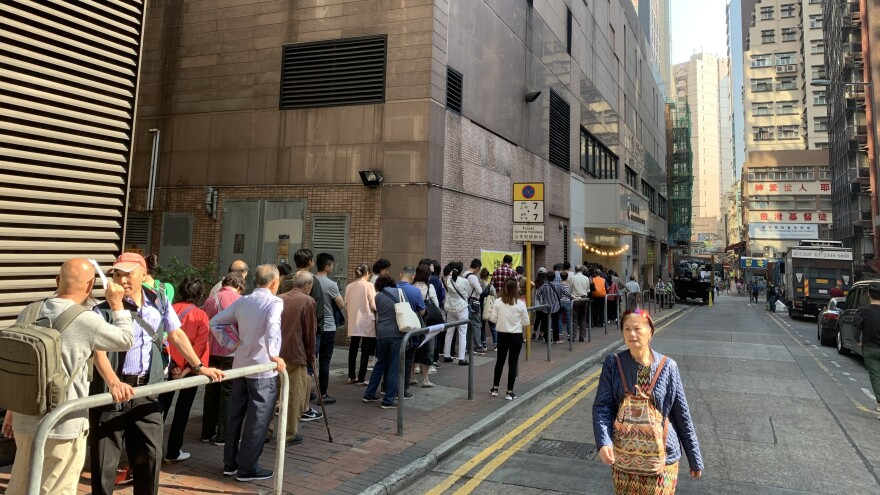 Long lines of voters waited to vote in Hong Kong's district council elections on Sunday.