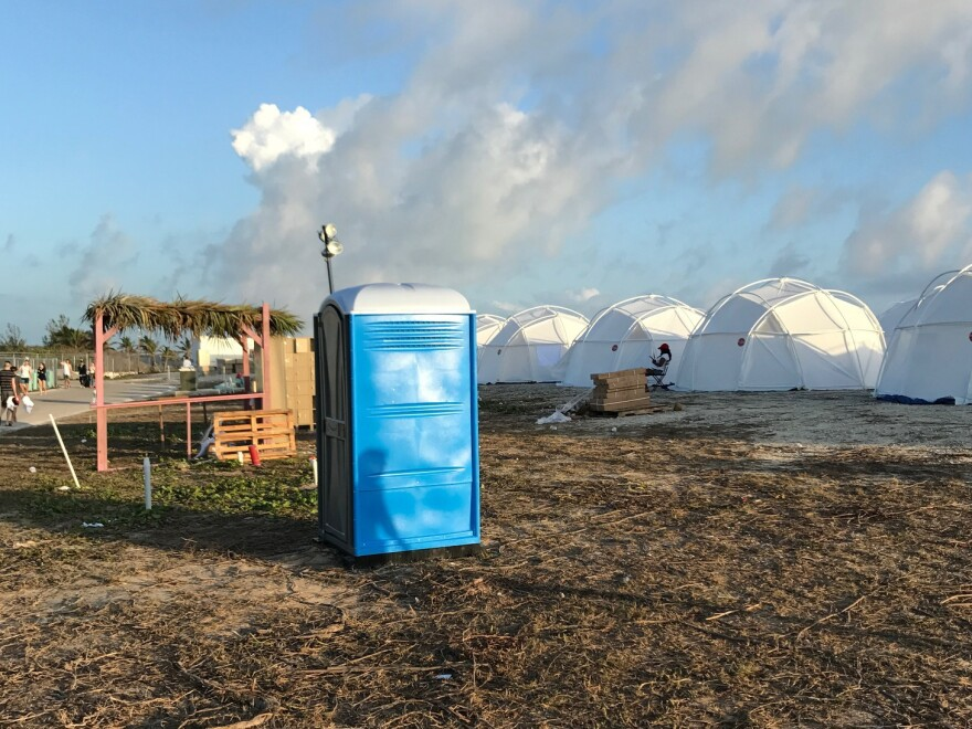 Tents and a portable toilet set up for attendees for the Fyre Festival on Friday, in the Bahamas' Exuma islands.