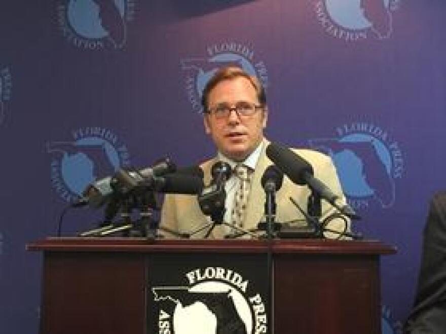 Brad Ashwell, a researcher with Integrity Florida, speaks about the political influence of charter companies at a press conference on September 19, 2018