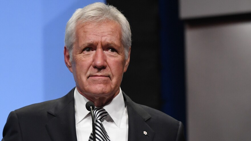 <em>Jeopardy!</em> host Alex Trebek speaks as he is inducted into the National Association of Broadcasters' Broadcasting Hall of Fame in Las Vegas in April 2018. On Wednesday, he revealed that he was diagnosed with pancreatic cancer.