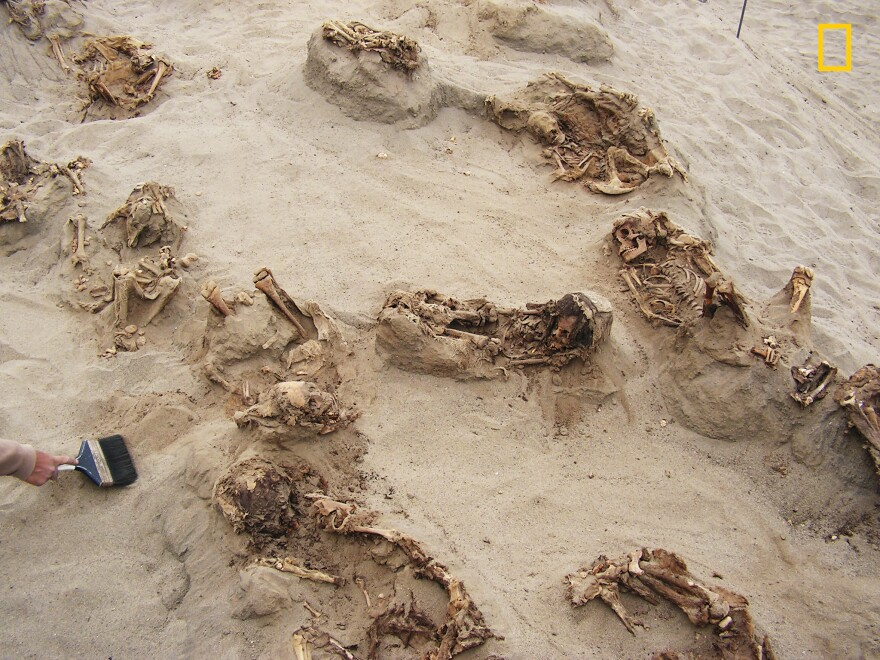 "Preserved in dry sand for more than 500 years, more than a dozen bodies were found by archaeologists. The researchers reported the ""remains were of children, ranging in age from approximately five to fourteen years."""