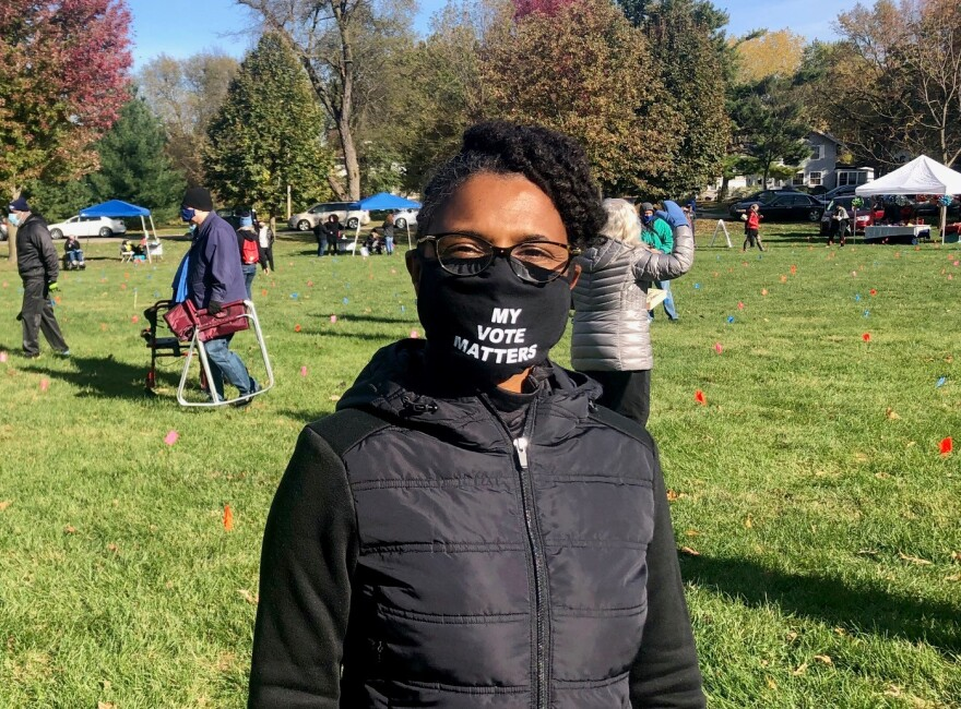"""Brandi Miller is pictured at an outdoor event wearing a mask that says """"my vote matters."""""""