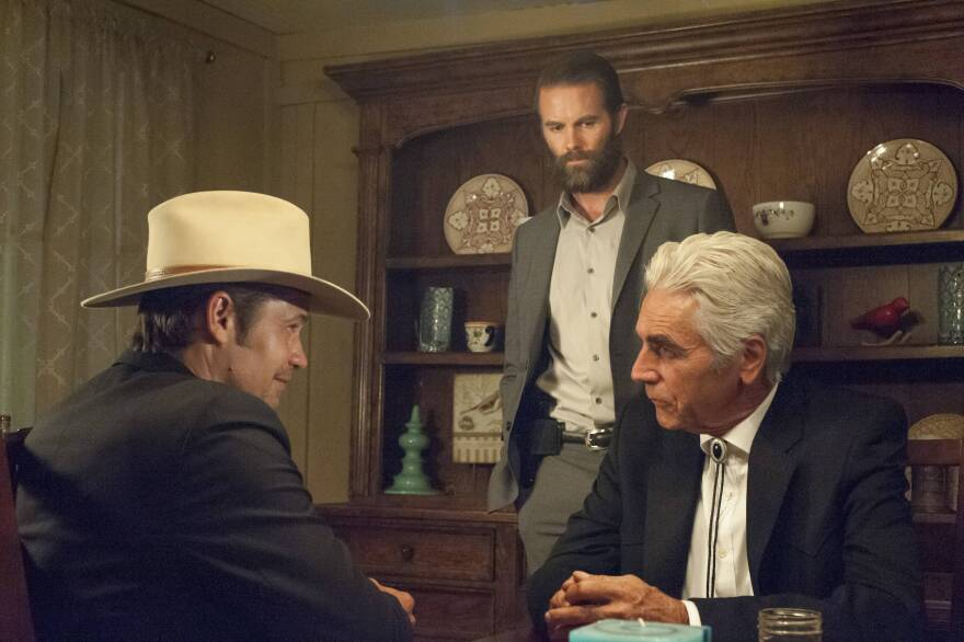 Deputy U.S. Marshal Raylan Givens (Olyphant, left) meets with security expert Ty Walker (Garret Dillahunt, center) and gangster Avery Markham (Sam Elliott). Yost says the show is violent but it can't be too violent because of the network's parameters.