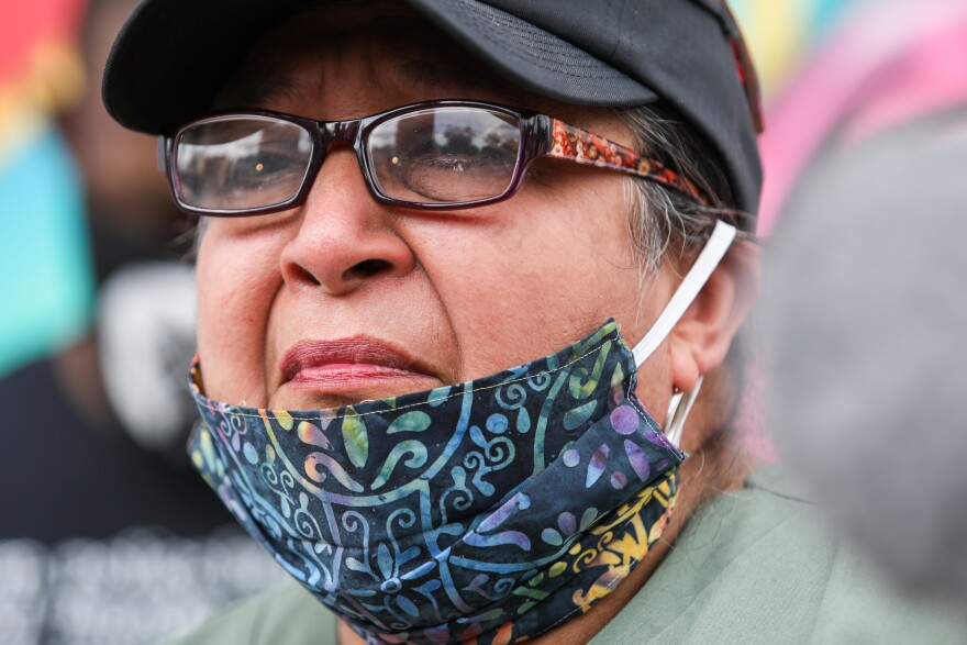 Brenda Ramos speaks on Tuesday in front of the mural honoring her son, Mike.