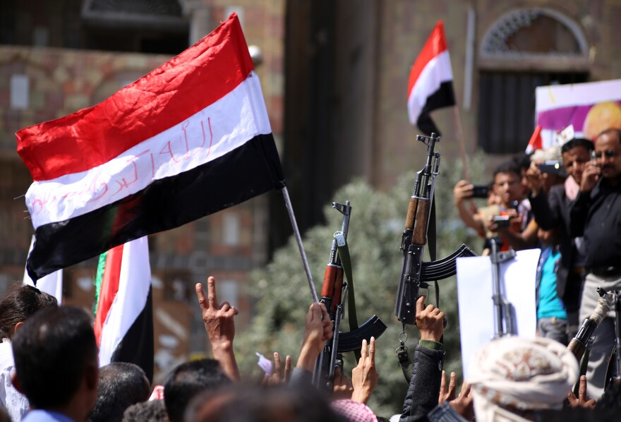 Yemenis wave their national flag during a rally commemorating the anniversary of the 2011 Arab Spring uprising that toppled the then-President Ali Abdullah Saleh, on Feb. 11, 2016, in the southern city of Taez. This year the Middle Eastern country marks the 10th anniversary of the uprising.