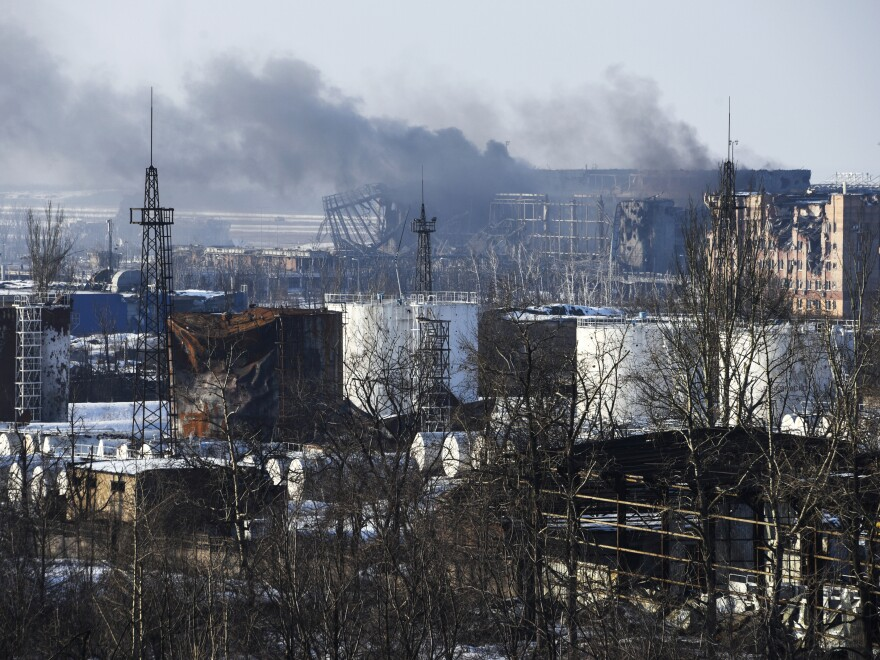 Smoke rises over the new terminal of Donetsk airport in Donetsk, Eastern Ukraine, where government troops have launched an offensive to capture the area from Russian-backed separatists.