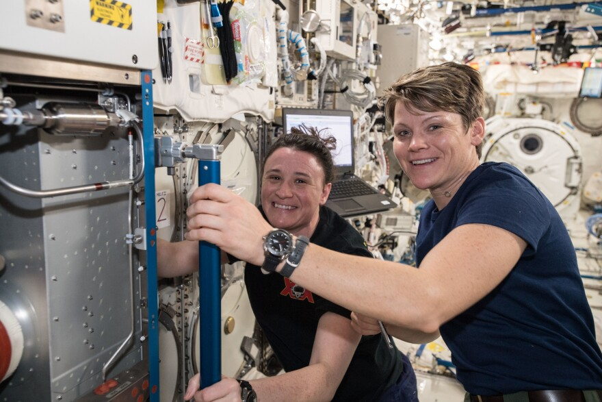 NASA astronaut Anne McClain, in foreground, training with a fellow astronaut before departing for the International Space Station in December 2018.