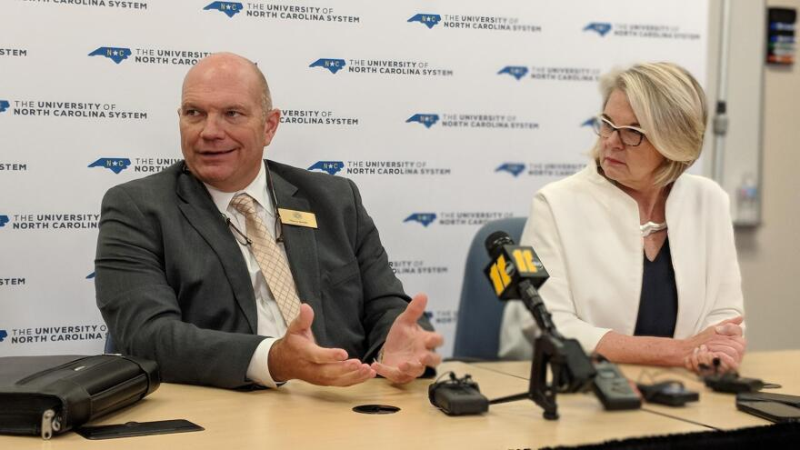 File photo of UNC Board of Governors Chairman Harry Smith and former UNC system President Margaret Spellings responding to questions about the aborted Western Carolina University chancellor search at a July 27, 2018 press conference.