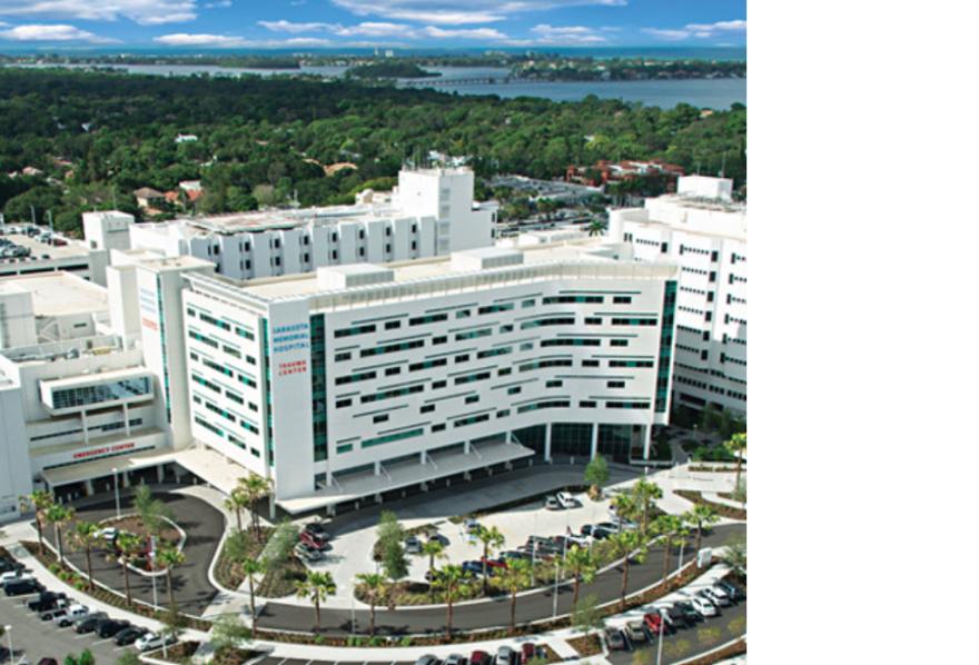 aerial shot of large white hospital