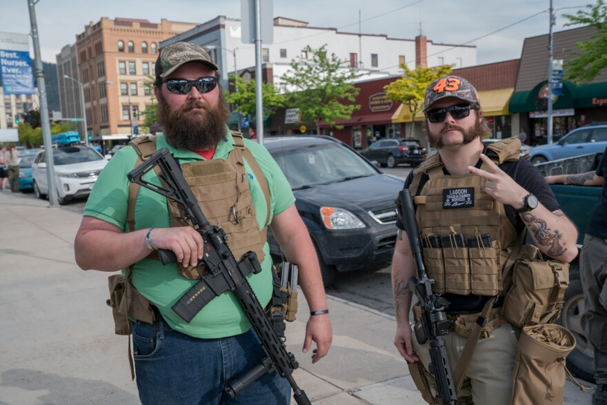 Max Metcalf (right) and Justin, who declined to provide his last name, say they are at a protest in Missoula to protect peaceful demonstrators. They are unaffiliated with the military or the police.