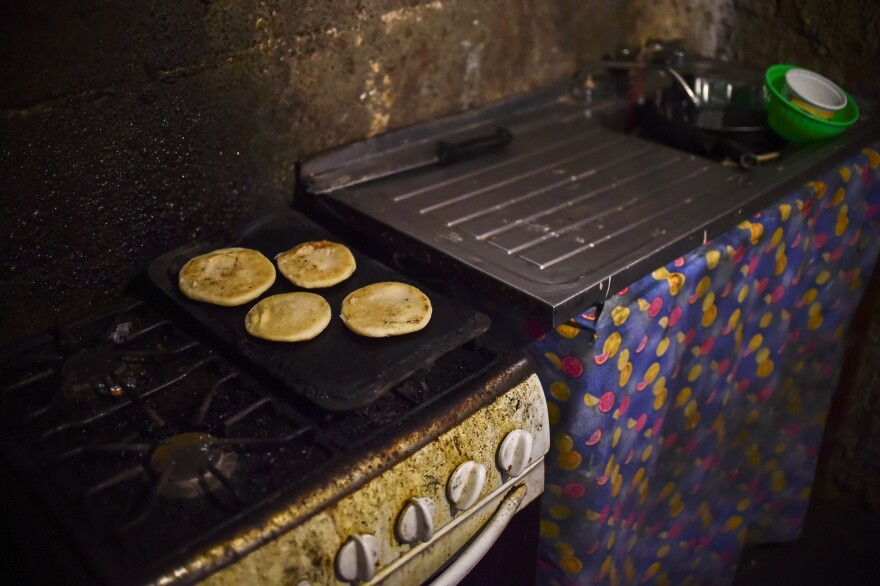 Arepas are prepared in a home in Caracas, Venezuela, last summer. Widespread corn shortages have made the Venezuelan staple less common.