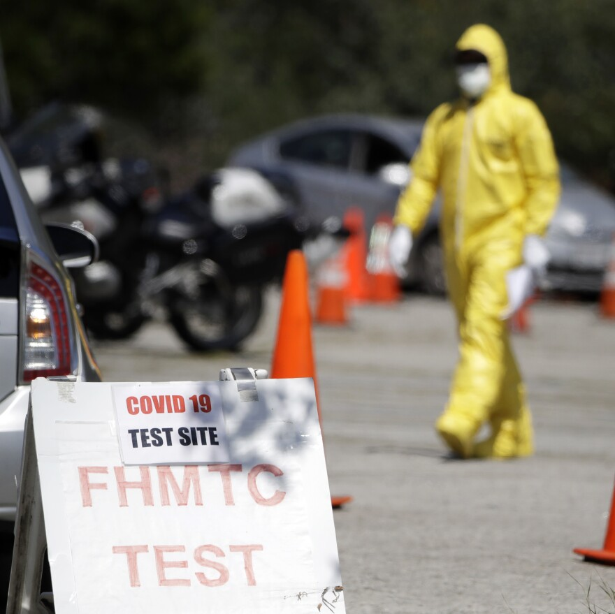 A person wearing protective equipment at a coronavirus testing site for first responders, on Monday in Los Angeles.
