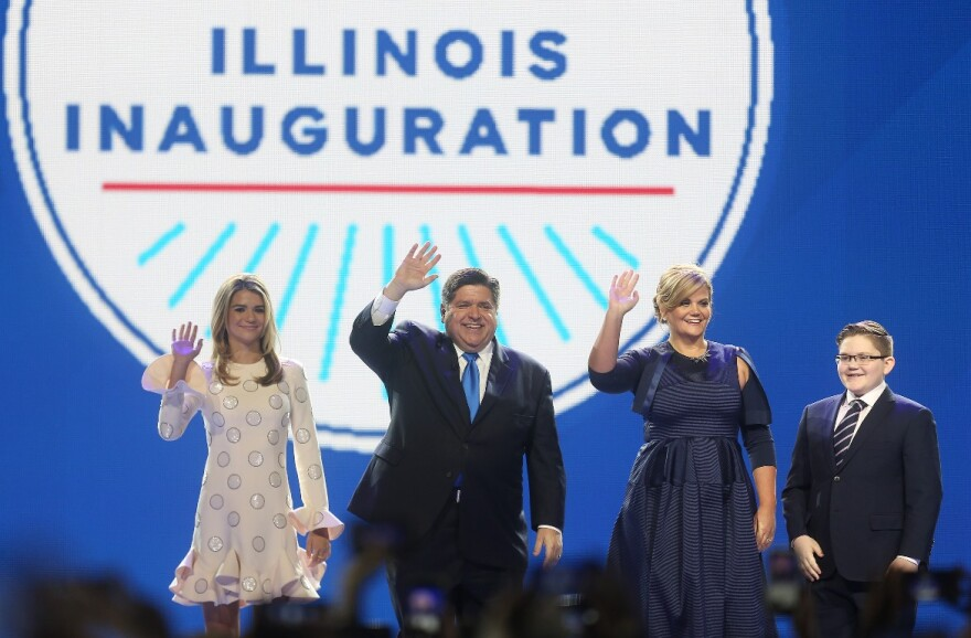 Illinois Governor J. B. Pritzker enters the stage with his family before taking the oath of office to become the 43rd Governor of the State of Illinois, at the Bank of Springfield Center in Springfield, Illinois on January 14, 2019.