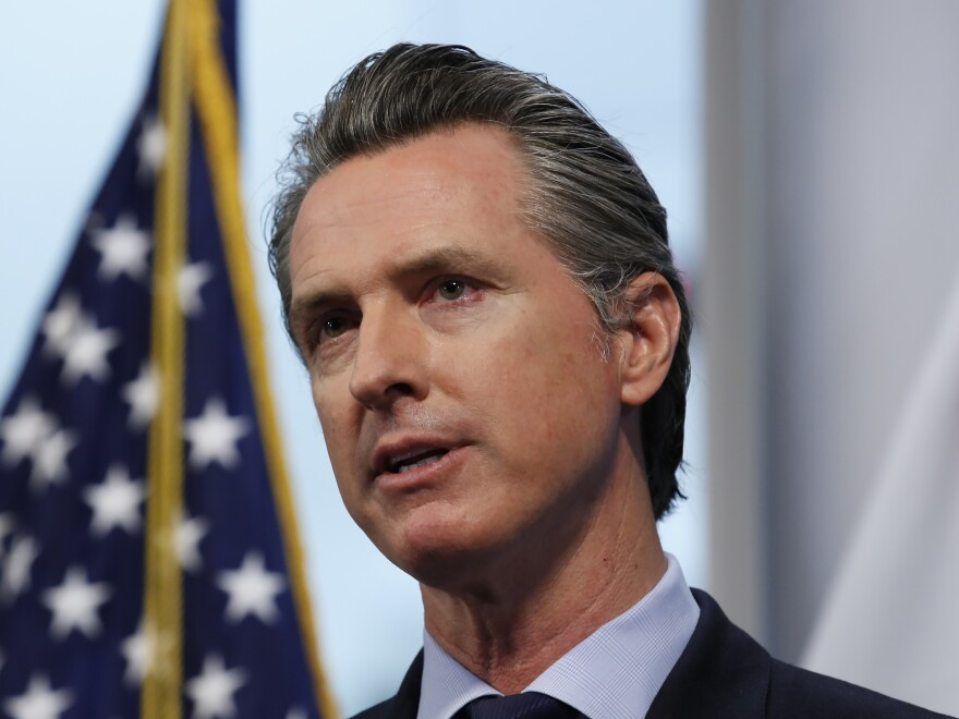 California Gov. Gavin Newsom, shown here earlier this month, has explained how the state will decide to lift restrictions imposed due to the coronavirus pandemic.