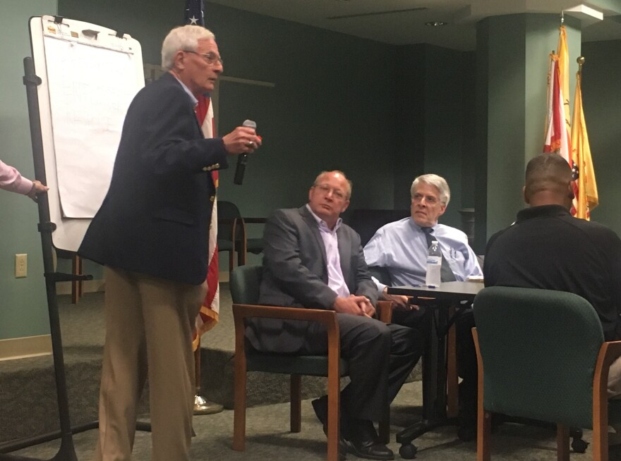 Jacksonville City Councilman Bill Gulliford stands leading an opioid action meeting, Monday. Sitting beside him are councilman Scott Wilson and Dr. Raymond Pomm.