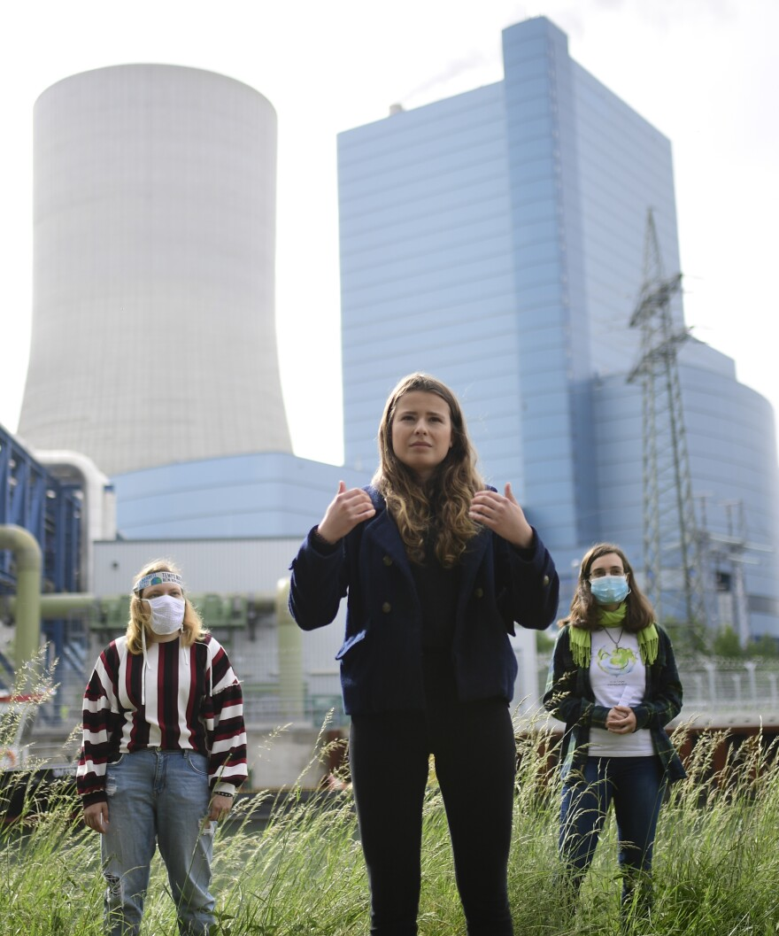 Neubauer (center) gives a statement during an action campaign at a coal-fired power plant of power supplier Uniper in Datteln, Germany, on May 20. the day the company was holding a virtual annual meeting with shareholders.