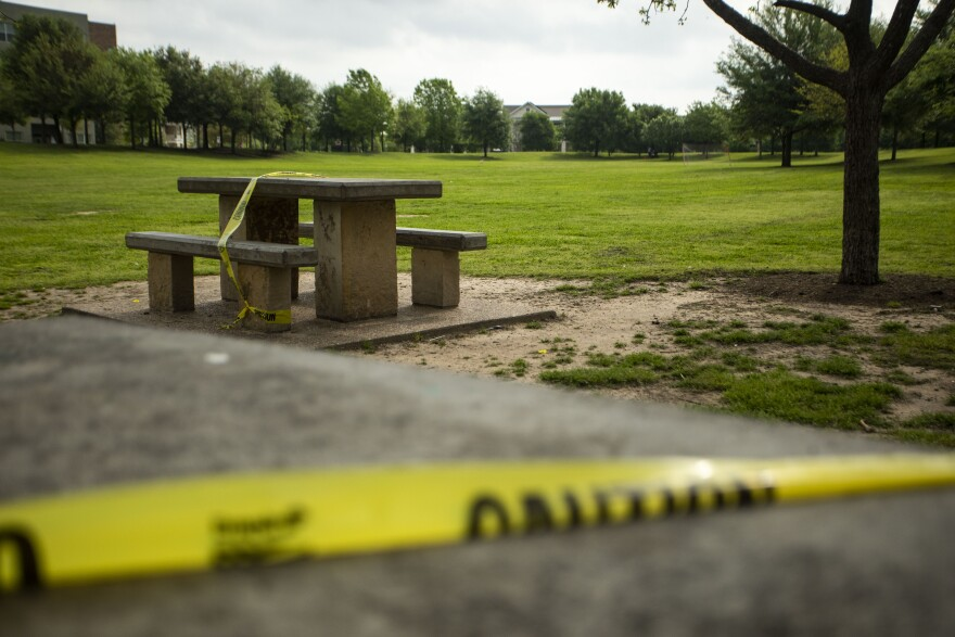 Caution tape is placed over tables at Mueller Lake Park. The city has closed park amenities in an effort to slow the spread of the coronavirus.