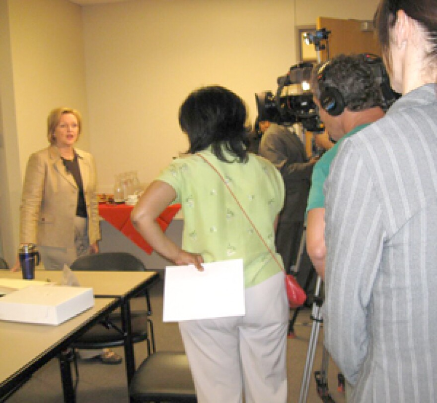 Sen. Claire McCaskill talks to the media at a foreclosure clinic Saturday. 300 pixels. 2008