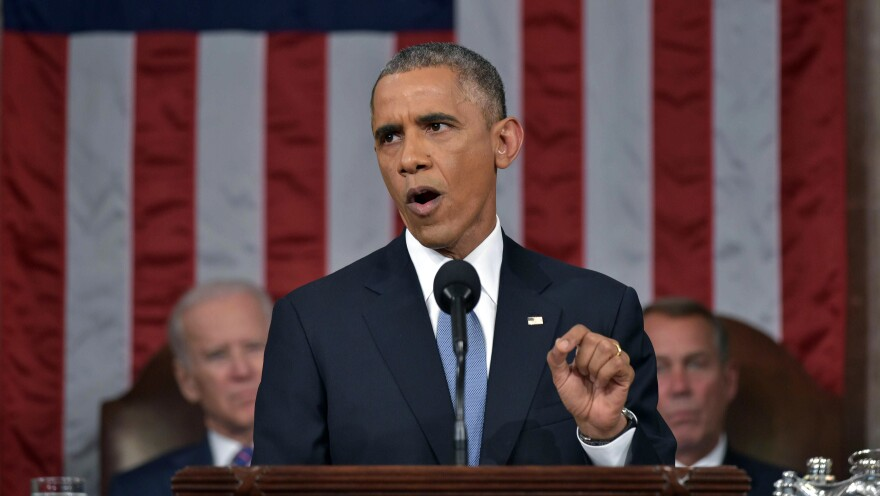 President Obama delivers his State of the Union address to a joint session of Congress on Jan. 20. Vice President Joe Biden and House Speaker John Boehner of Ohio listen in the background.