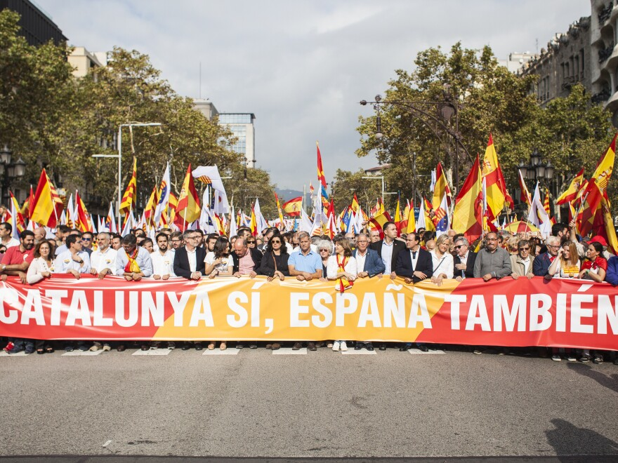 People rally in Barcelona for Spain's National Day on Thursday, shouting against the independence of Catalonia.