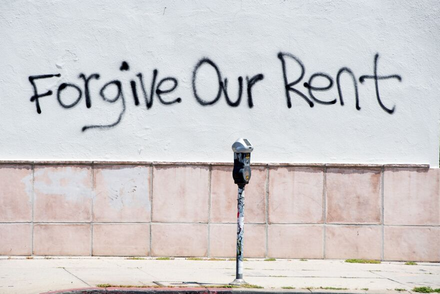 Graffiti on a wall on La Brea Ave. in Los Angeles, Calif. asking for rent forgiveness in May. This week, the city of Los Angeles rolled out a renters relief program to provide more than $100 million in assistance.